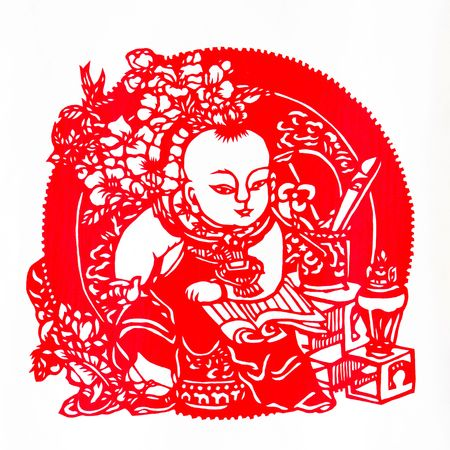 Reading.This is a Chinese paper-cut, reflecting the childrens happy life scenes. photo