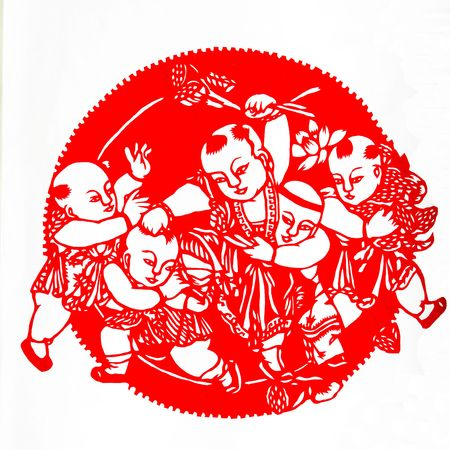 Picking lotus.This is a Chinese paper-cut, reflecting the childrens happy life scenes. photo