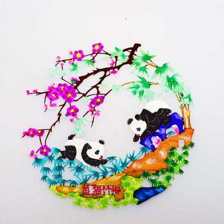 scenarios: panda.This is a Chinese paper-cut, reflecting the animal a happy life scenarios. Stock Photo