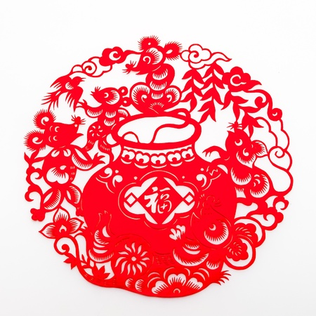 """Chinese traditional paper-cutting.Some happy mice around a Chinese character of """"happiness"""". photo"""