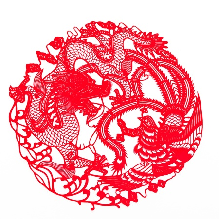 Chinese traditional paper-cutting.Dragon and phoenix bringing prosperity and great fortune. Stock Photo