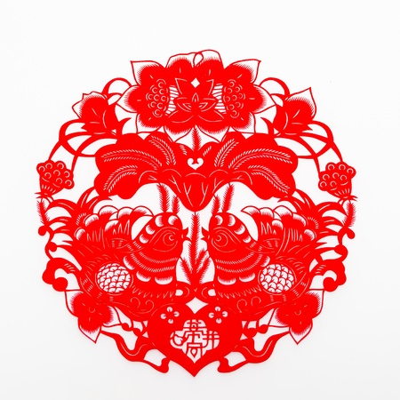 auspicious element: Chinese traditional paper-cutting.This is a picture of the Chinese paper cutting. Paper-cutting is one of the traditional Chinese arts and crafts. The paper-cutting dates back to more than 1,000 years ago. In China, this folk art is royalty-free. Stock Photo