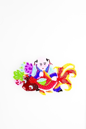 seedpod: Child and Carp.An immortal child in traditional Chinese clothes holding a big carp, with a lotus seedpod in his hand, and peonies behind.