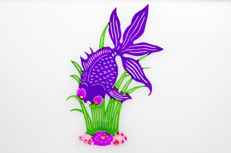 waterweed: Goldfish and Waterweed.A purple goldfish is swimming around waterweeds and flowers