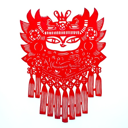 headgear: Child in Dragon Headgear.A traditional Chinese paper cutting of a chubby child in dragon headgear, with strings of Chinese knot in the front. Stock Photo