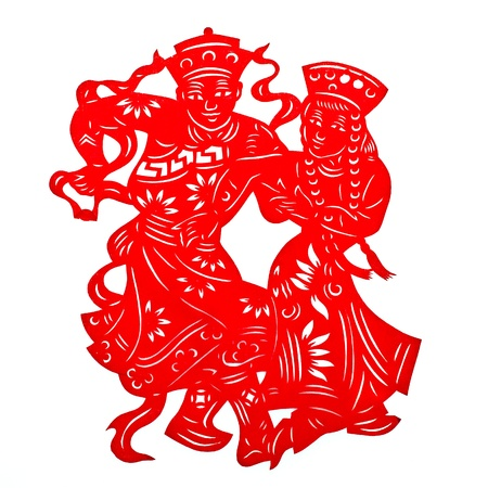 auspicious element: Chinese Minority Couple.A traditional Chinese paper cutting of a minority couple walking and playing musical instruments. Stock Photo