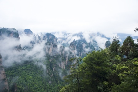 world natural heritage: Mysterious Zhangjiajie A World Natural Heritage in South China, Zhangjiajie is consisted of more than 3,000 quartz sandstone pillars, and many Karst caves