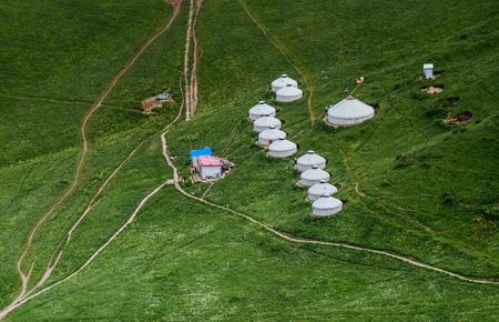 Urumqi Grassland with Mongolian yurts Imagens - 96686789
