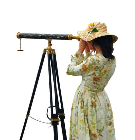 Girl in fancy dress and hat looking through telescope - isolated. photo