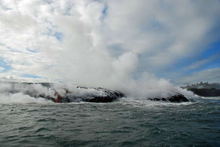 Advancing Lava, Ocean, Steam, Sky, Red hot lava flows into the ocean, bringing up clouds of steam and toxic gas, adding new land to the Big Island. Stok Fotoğraf
