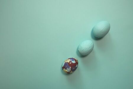 Easter colored eggs on a blue background. Located diagonally. View from above.