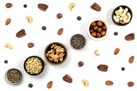 Nuts in round cup, top view close up. On white background. in round cup, top view close up. On white background.