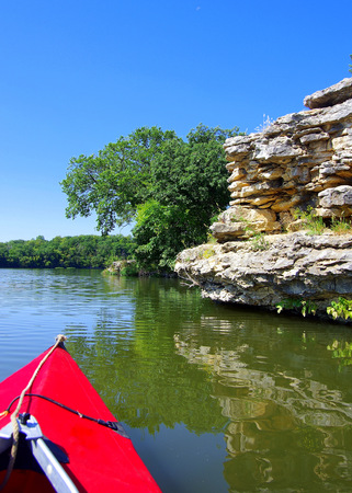 Kayaking toward the rock ledge at the lake