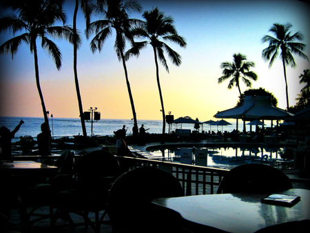 Musicians playing at sunset on a hotel terrace at Waikiki beach Banco de Imagens
