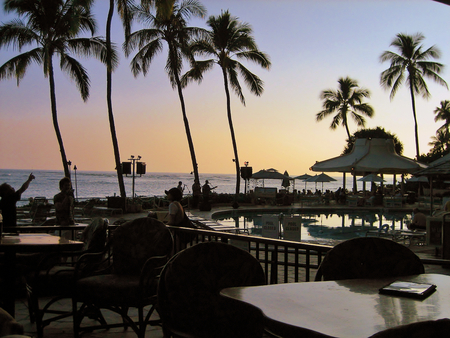 Oceanfront restaurant on Waikiki beach at sundown