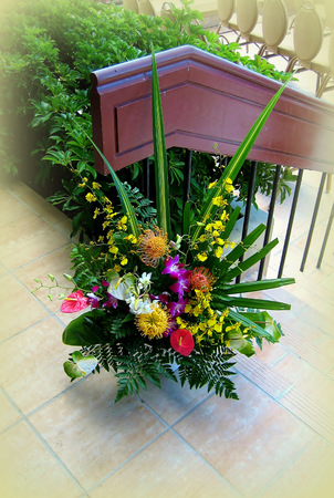 A spray of exotic tropical flowers on a terrace