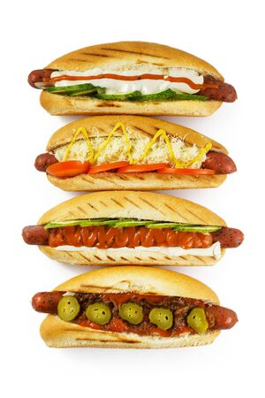 isolated hot dogs with different fillings photographed from above Stockfoto