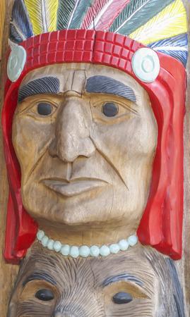 Totem with Native American mask, Glacier Park,Montana,USA
