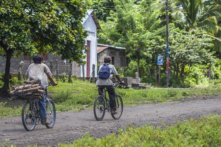 People riding bike, island way of life, Ometepe Island, Rivas, Nicaragua