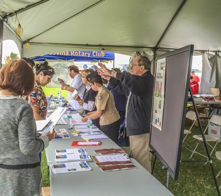 valor: Rotary Club members providing information to the public, Veterans   Field of Valor at Sierra Vista Middle School,  Covina, CA.USA