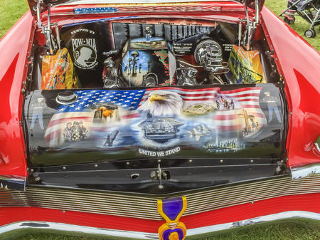 valor: Chevy 1956 engine with Vets themes and symbols, Veterans Field of Valor at  Sierra Vista Middle School,  Covina, CA.USA