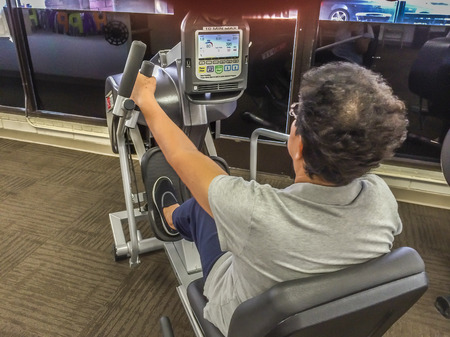 body toning: Bike exercise at the gym, healt and fitness