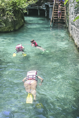 mayan riviera: Tourist swimming the Xcaret park underground river, Quintana Roo, Mexico. Editorial