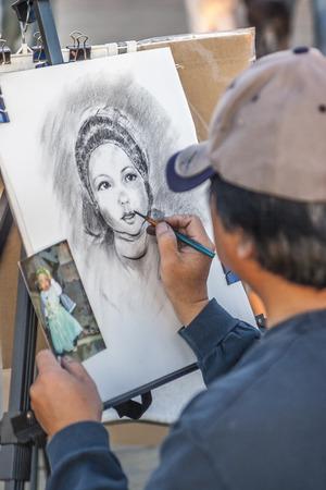 monica: Artist at work, Santa Monica Pier, Santa Monica CA. USA. Editorial