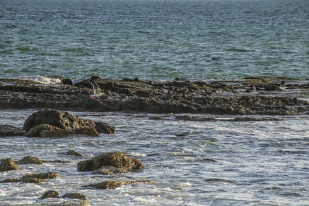 state of mood: Rocky shores at White point beach, San Pedro, CA. USA. Stock Photo