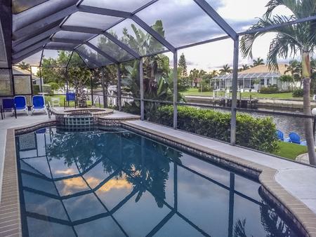 Sky reflection on  covered pool at Punta Gorda, Florida, USA. Editorial