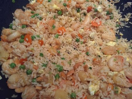 Home made Fried rice shrimp with eggs, petit pois peas,carrots and cashew.
