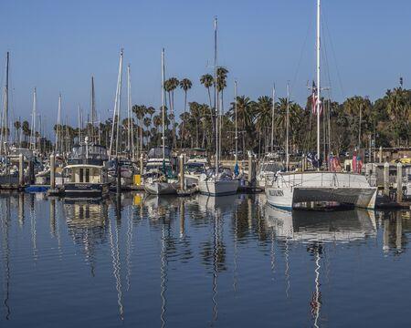 Boats water reflection at the Santa Barbara Marina, Santa Barbara, California, USA.