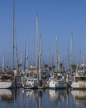 Luxury yachts docking under blue sky at the Santa Barbara marina, California, USA Redakční