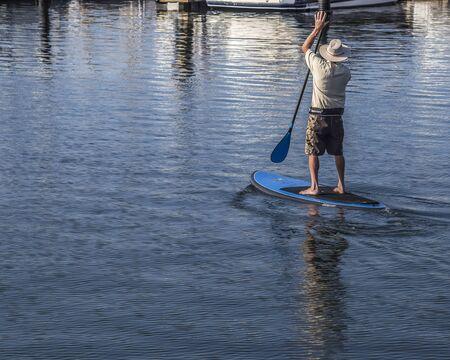 Man paddling and enjoying the morning breeze at the Santa Barbara marina, California, United Staes.