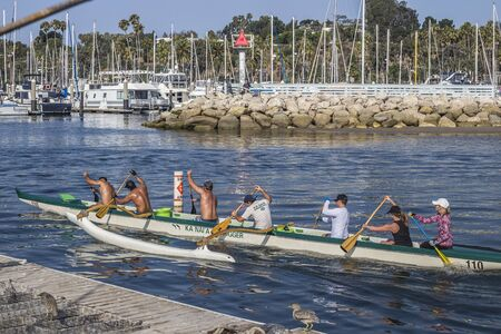 Six Kanai Outrigger Team members paddling at the Santa Barbara coast, California, United States Redakční