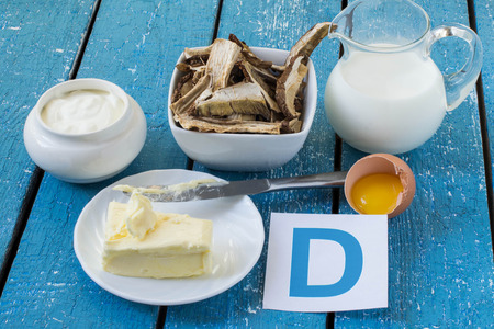 Foods containing vitamin D: cream, sour cream, porcini mushrooms, butter, egg yolk 版權商用圖片