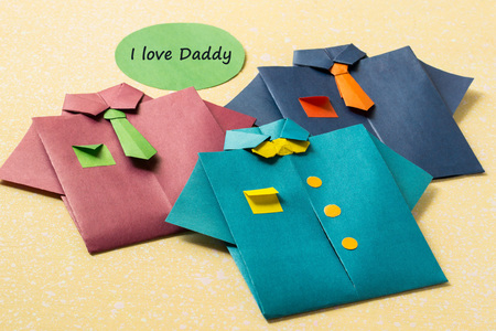 origami: The idea of design for Fathers day: shirts from paper technique origami and the words: I love daddy Stock Photo