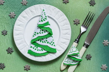 decoration objects: Sample Christmas table decoration with fir trees from the napkins on the cutlery