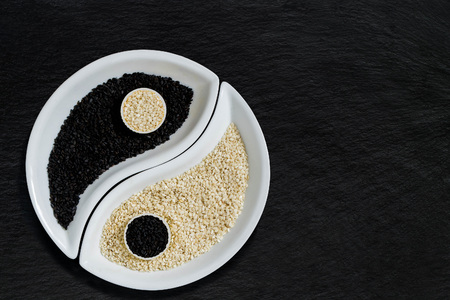 white sesame seeds: Oriental cuisine ingredients - black and white sesame seeds in the form of Yin Yang symbol