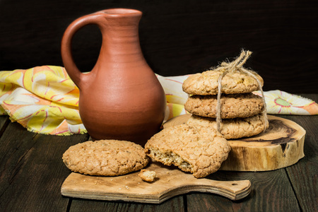 oatmeal cookie: Delicious homemade oatmeal cookies and milk in a jug