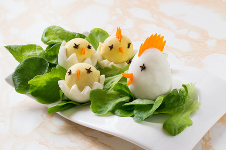 lettuce: Easter appetizer of boiled eggs in the form hen with chicks on lettuce leaves