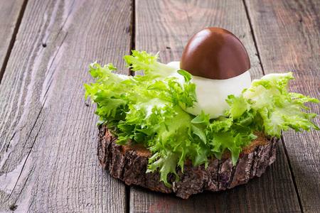 farci: Original appetizer of stuffed egg in the form of porcini on lettuce leaves