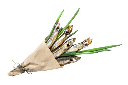 cornet: Smoked capelin with green onions in paper cornet on white background. Top view