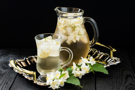 redolence: Refreshing cold green tea with jasmine and ice in a jug and a glass