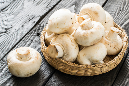 protein source: Fresh mushrooms in a basket. The source of protein, minerals, amino acids. Diet, health or vegetarian food concept Stock Photo