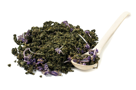 angustifolium: Dry fermented tea of fireweed (Chamerion angustifolium) also known as great willowherb or rosebay willowherb on white background. Traditional Russian Koporye Tea (Ivan Chai). Useful herbal tea Stock Photo