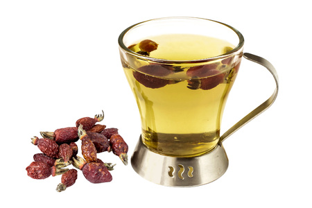 majalis: Useful tea with dried fruits rosehip (Rosa majalis) isolated on a white background. Used in healthy nutrition and herbal medicine Stock Photo