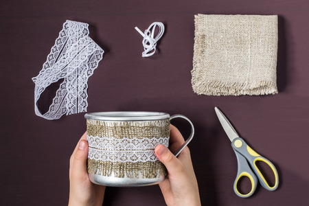 Burlap eco-decor. Homemade making of decor of burlap and lace for aluminum mug. DIY concept. Step by step photo instructions. Step 3. Attach the lace strip to burlap
