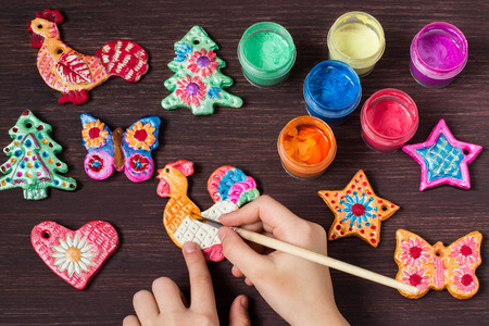 Making toys for Christmas decorations from salt dough with your own hands. Childrens art project. DIY concept. Step by step photo instructions. Step 7. Painting toys Stock Photo