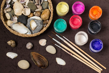 Hand-painted colorful dot patterns on sea pebbles and shells. Childrens art project, a craft for children. DIY concept. Step by step photo instructions. Step 1. Preparation of materials and tools